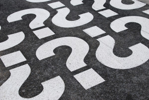 question mark signs painted on a asphalt road surface